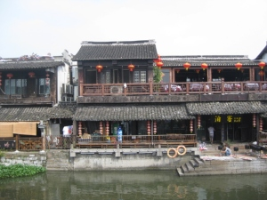 Homes and shop establishments along the river embankment, with famous covered lanes and corridors.