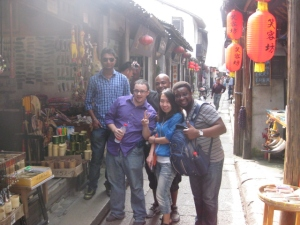 Quick picture of cohorts along shopping corridor in Xitang. (from left:  (Vicky, Ted, Ali, Shaw, and Lanre)