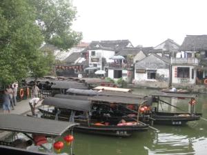 River Boats along embankment of Xitang shopping area.