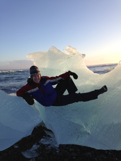 Katie playing on a glacier piece.